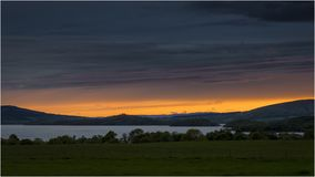 Sonnenuntergang bei Loch Lomond - Schottland Stockbild