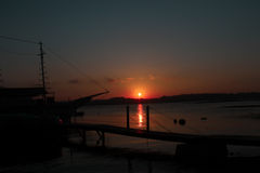 Sonnenuntergang, Boot, Farben, Frieden und Natur Stockfoto