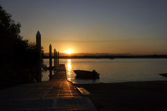 Sonnenuntergang an der Anlegestelle Stockfotos