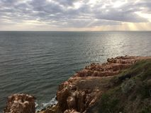 Sonnenuntergang durch die Wolken Lizenzfreie Stockfotografie