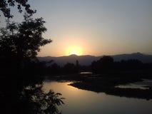 Sonnenuntergang in einem Tal Lizenzfreies Stockbild