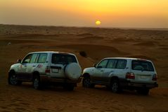 Sonnenuntergang an einer Wüste Stockbilder