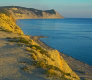 Sonnenuntergang, Felsen und Meer Lizenzfreie Stockfotos