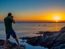 Sonnenuntergang-Fotograf stockfotos