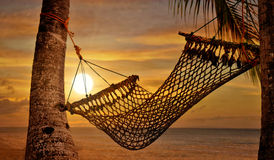 Sonnenuntergang-Hängematte Lizenzfreies Stockbild