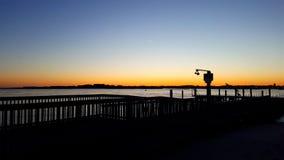 Sonnenuntergang am Hafen Stockbild
