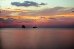 Sonnenuntergang im Strand Stockfotos