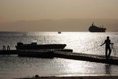 Sonnenuntergang in Jordanien am Strand Lizenzfreies Stockfoto