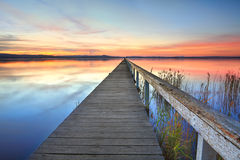 Sonnenuntergang am langen Anlegestelle Tuggerah See NSW Australien Stockfotos