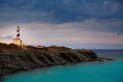 Sonnenuntergang-Leuchtturmkap Cap de Favaritx in Mahon Stockfotos