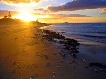 Sonnenuntergang an Papamoa-Strand, Neuseeland Lizenzfreie Stockfotos