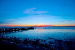 Sonnenuntergang am Pier Stockbilder
