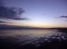 Sonnenuntergang-Sand-Kräuselungen Stockfoto