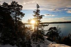Sonnenuntergang, Schnee und Meer Lizenzfreie Stockfotos