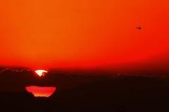 Sonnenuntergang in spätem sonnigem Stockfoto