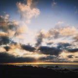 Sonnenuntergang am Strand Lizenzfreies Stockbild