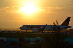 Sonnenuntergang Tigerair A320 Stockfotos