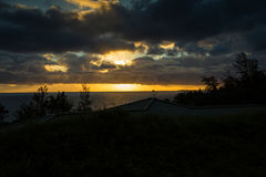 Sonnenuntergang und das Ozean eingelassene Hawaii Stockbilder