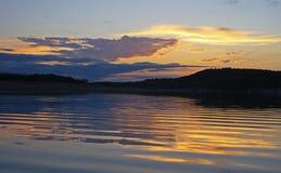 Sonnenuntergang und Kräuselungen Lizenzfreies Stockfoto
