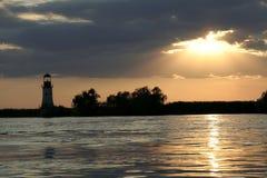 Sonnenuntergang und Leuchtturm Stockfotografie