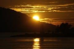 Sonnenuntergang und Leuchtturm Stockfotos
