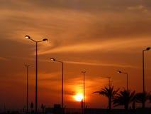Sonnenuntergang und sillouettes Lizenzfreie Stockbilder