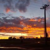 Sonnenuntergang von Flammen Stockbilder