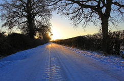 Sonnenuntergang-Weg in Schnee 004 Lizenzfreie Stockfotos