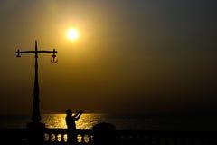Sonnenuntergangelektrizitätspfosten Lizenzfreies Stockbild