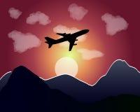 Sonnenuntergangfliegenflugzeug Stockfoto