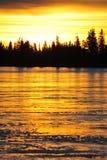 Sonnenunterganghimmel- und -eissee Lizenzfreie Stockfotografie