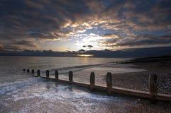 Sonnenuntergangküstenszene stockfoto