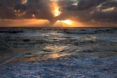 Sonnenunterganglichtstrahlen Stockbilder