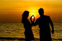Sonnenuntergangpaare Stockbild