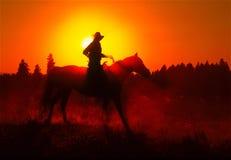 Sonnenuntergangpferdereiter Lizenzfreie Stockfotografie