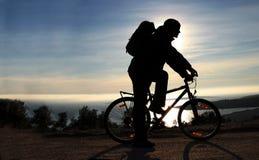 Sonnenuntergangradfahrer Stockbilder