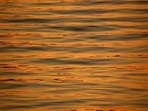Sonnenuntergangreflexion auf Meer Lizenzfreie Stockfotos