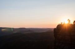 Sonnenuntergangschwingungen Stockbild