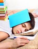 Sonno dell'adolescente con i libri Immagine Stock Libera da Diritti