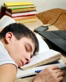 Sonno dello studente con libri Immagini Stock