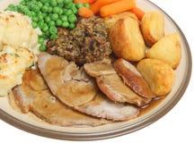 Sonntags-Braten-Schweinefleisch-Abendessen-Mahlzeit Stockfotos