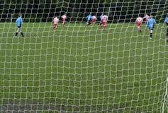 Sonntags-Morgen-Fußball stockbild