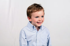 Sonny Boy. Little boy laughing isolated on white background Royalty Free Stock Images