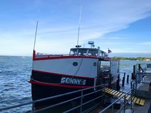 Sonny S Ferry. Middle Bass Island, Ohio - May 27, 2017 Ferry at dock preparing to transport passengers from Middle Bass Island to Put in Bay stock photography
