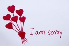 Sono carta spiacente del messaggio con il cuore rosso di tiraggio fotografia stock libera da diritti