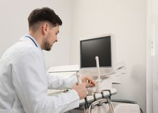 Sonographer operating modern ultrasound machine. In clinic stock photos