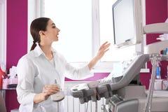 Sonographer using modern ultrasound machine royalty free stock photo