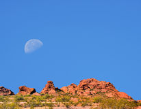 Sonora Desert Moon. Desert moon over the southwestern USA Sonora desert and mountains with water tanks Royalty Free Stock Photography