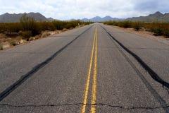 Sonora desert road with saguaro cactus Royalty Free Stock Image