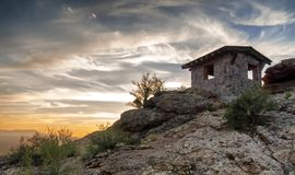 Sonoran Desert Sunset. Hiker's cabin overlooking the mountains and Avra Valley from Gates Pass in the Tucson Mountains in southern Arizona stock image